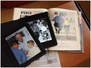 Tablette et livre avec le tableau de Norman Rockwell.